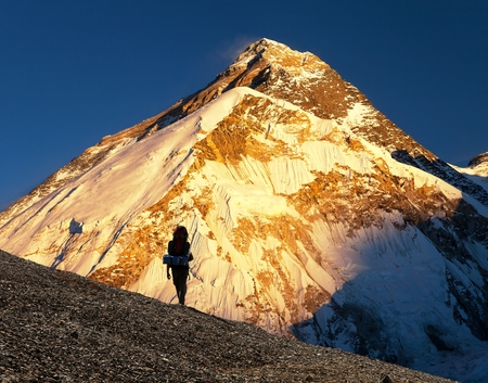 Evening view ofmount Everest from Pumo Ri base camp with tourist on the way to Everest base camp - Nepal Himalayas mountains Stock Photo