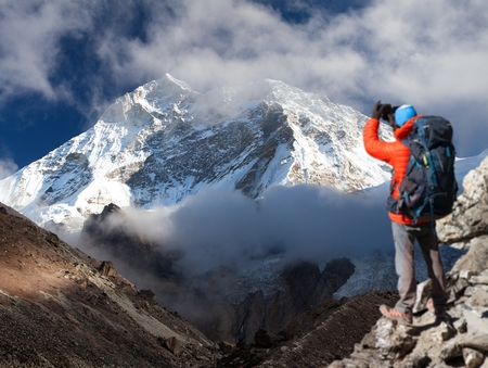 Mount Makalu with clouds and tourist, Nepal Himalayas mountains, Barun valley