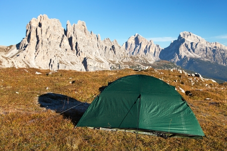 Panoramic view of Cima Ambrizzola, Croda da Lago and Tofano Gruppe with green tent, Dolomites mountains, Italy