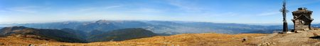 Panoramic view from Ukraine Carpathian mountains with crucigix and small chapel