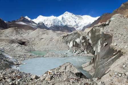View of mount Cho Oyu and lake on Ngozumba glacier near Gokyo village - Gokyo trek, trek to Cho Oyu base camp and three passes trek, Gokyo valley, Sagarmatha national park, Nepal Himalayas mountains