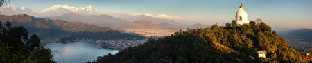 Evening panoramic view of world peace stupa, Phewa lake, Pokhara and great himalayan range, Annapurna, Manaslu, Nepal Himalayas mountains
