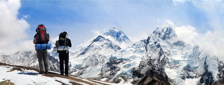 Panoramic view of Mount Everest from Kala Patthar with two tourists on the way to Everest base camp, Sagarmatha national park, Khumbu valley Solukhumbu - Nepal Himalayas mountains