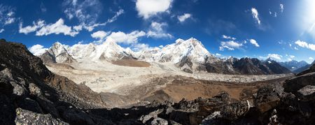 Panoramic view of Everest, Pumori, Kala Patthar and Nuptse with beautiful clouds on sky, Khumbu valley and glacier, Sagarmatha national park, Nepal Himalayas mountains