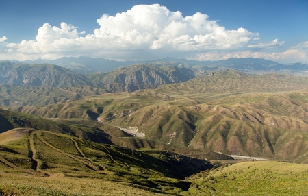 Tian Shan mountains in Kyrgyzstan, panoramic view of steppe kyrgyz mountains