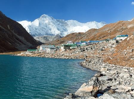 View of Gokyo lake and village with mount Cho Oyu - Gokyo trek, trek to Cho Oyu base camp and three passes trek, Gokyo valley, Sagarmatha national park, Khumbu valley, Nepal Himalayas mountains