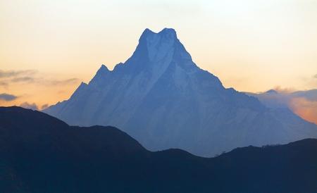 Silhouette of mount Machhapuchhre, round Annapurna circuit trekking trail, morning view, Nepal himalayas mountains