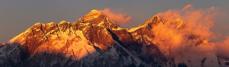 Evening sunset red colored view of mount Everest Lhotse and Nuptse south rock face with beautiful clouds from Kongde village, Khumbu valley, Solukhumbu, Nepal Himalayas mountains