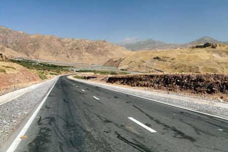 Pamir highway or pamirskij trakt Landscape around Pamir highway M41 international road mountains in Tajikistan roof of the world Stock Photo - 124963167