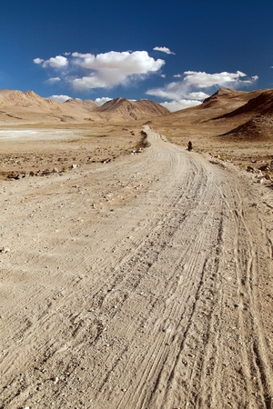 Pamir highway or Pamirskij trakt with biker, there is one of the best cycling road on the world. Unpaved road in Tajikistan, roof of the world Stock Photo