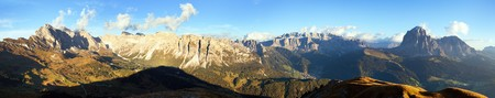 Evening panoramic view of Geislergruppe or Gruppo delle Odle and Sella gruppe or Gruppo di Sella, Alps Dolomites mountains, Dolomiti, Italy Stock Photo