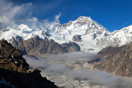 View from Gokyo Ri to mount Gyachung Kang 7952m within clouds near Cho Oyu and Ngozumba glacier, three passes trekking route, Sagarmatha national park, Khumbu valley, Nepal Himalayas mountains