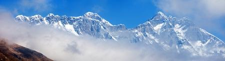 Top of mount Everest and Lhotse south rock face blue colored mountain view, Sagarmatha national park, Khumbu valley, Nepal Himalayas
