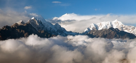 Evening view on top of mount Makalu in the middle of clouds, Nepal Himalayas mountains Stock Photo