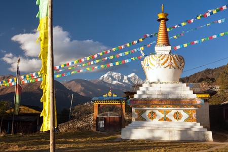 view of stupa, pagoda or chorten and prayer flags. Monastery in Sallery village, Nepal Himalayas mountains