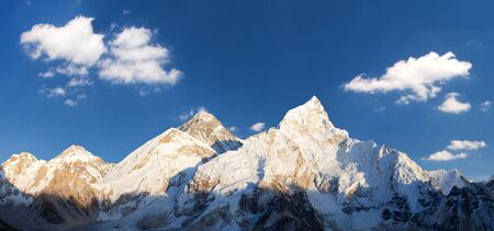 Evening sunset panoramic view of mount Everest and mount Nuptse with beautiful blue sky and clouds from Kala Patthar, Khumbu valley, Sagarmatha national park, Nepal Himalayas mountains Stock Photo