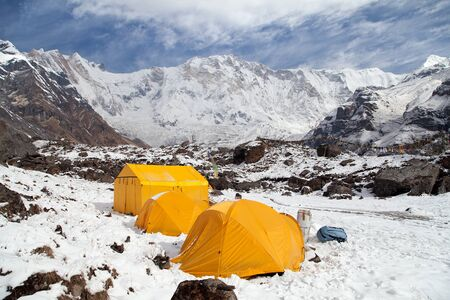 View of Mount Annapurna with tents from Annapurna base camp, Nepal himalayas mountains