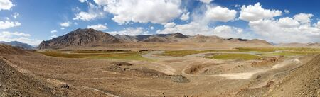 Beautiful landscape panorama of Pamir mountains area in Tajikistan Badakhshan. Landscape around Pamir highway or Pamirskij trakt. Banco de Imagens