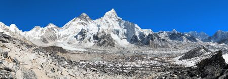 Panoramic view of himalayas mountains, Mount Everest with beautiful blue sky and Khumbu Glacier - way to Everest base camp, Khumbu valley, Sagarmatha national park, Nepalese himalayas
