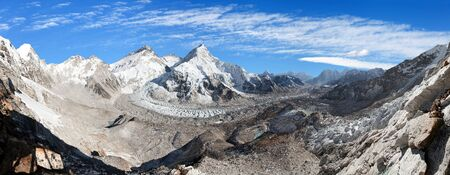 Beautiful view of Mount Everest, Lhotse and Nuptse from Pumo Ri base camp with blue clear sky - way to Everest base camp, Khumbu valley, Sagarmatha national park, Nepalese Himalayas mountains