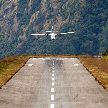 Lukla airport and airplane, Khumbu valley, Solukhumbu, Everest area, Nepal Himalayas, Lukla is the gateway for Everest trek and Khumbu valley.