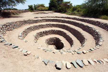 Cantalloc Aqueduct in Nazca or Nazca town, spiral or circle aqueducts or wells, Peru, Inca architecture and culture