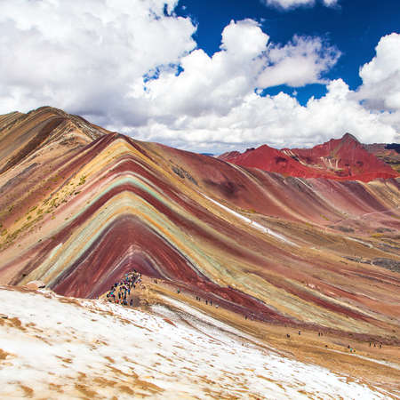 Rainbow mountains or Vinicunca Montana de Siete Colores with people, Cuzco region in Peru, Peruvian Andes, panoramic view Banco de Imagens