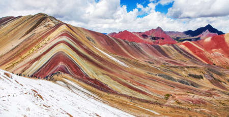 Rainbow mountains or Vinicunca Montana de Siete Colores with people, Cuzco region in Peru, Peruvian Andes, panoramic view