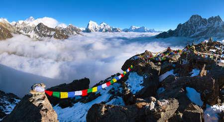 view from Gokyo Ri to mounts Everest Makalu and Lhotse with buddhist prayer flags, trek to Everest base camp and three passes trek, Nepal himalayas mountains Stock Photo