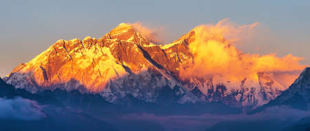Mount Everest and Lhotse with beautiful clouds from Kongde village, evening sunset red colored view, Khumbu valley, Solukhumbu, Nepal Himalayas mountains