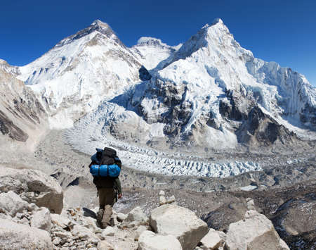 view of Mount Everest, Lhotse and Nuptse from Pumo Ri base camp with tourist on the way to base camp, Sagarmatha national park, Khumbu valley - Nepal Himalayas mountains