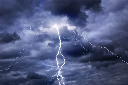 lightning storm: Heavy clouds bringing thunder, lightnings and storm Stock Photo