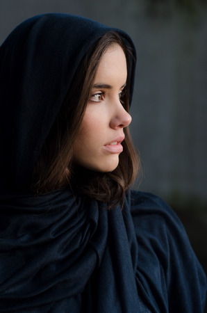 cute girl with long hair: Portrait of the beautiful muslim girl in blue robe. Stock Photo