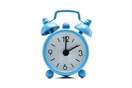 The blue alarm clock tells the time. Stock Photo