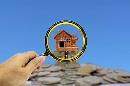 heap: Money to buy a home or a dream. Stock Photo