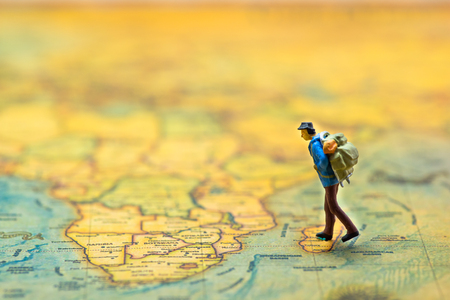 Travel Concept. Men with backpack to travel. mini figure Stock fotó