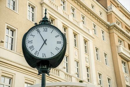 historical building: Clock in front of historical building Stock Photo