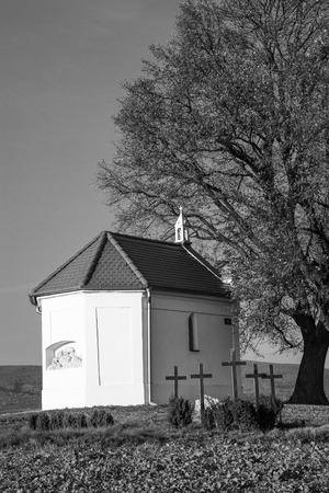 bw: The chapel under the tree BW Stock Photo