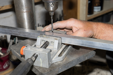 drilling machine: Hands at work, drilling machine in work, manual work, working hands