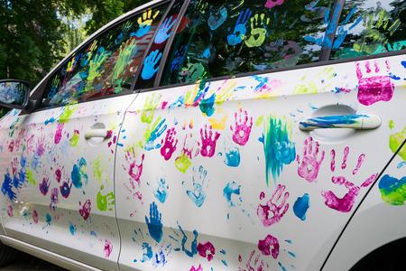 handprint: Colorful car decoration, multi-color handprint Stock Photo