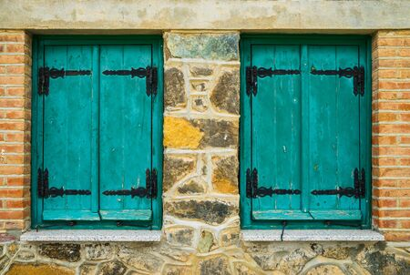 cypriot: Old cypriot house with two blue windows Stock Photo
