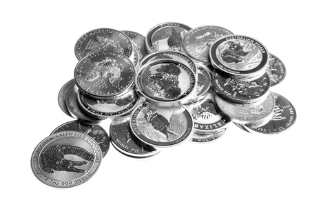 White table with silver coins, silver money Stock Photo