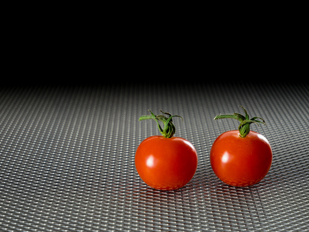 wire: Grid plate with two red tomatoes Stock Photo