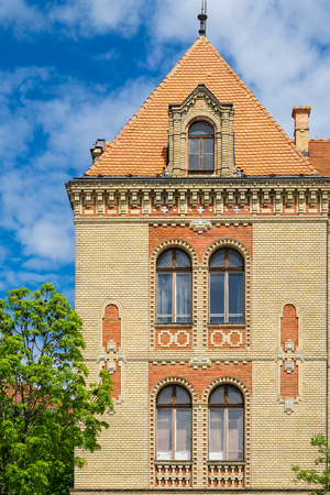 Building with brick facade, old historical building with 5 windows