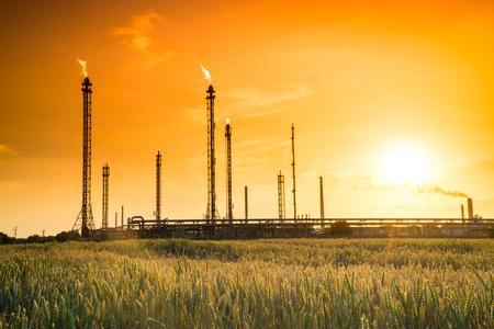 Refinery factory, potroleum factory silhouette at orange sunset Stock Photo