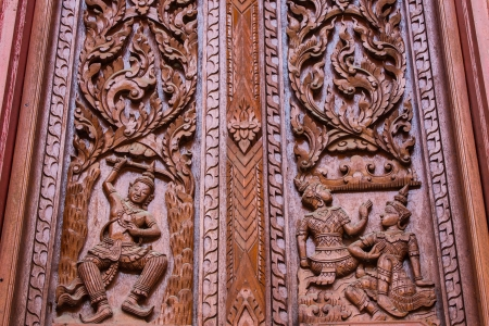 Carved wooden window in wat changkian photo