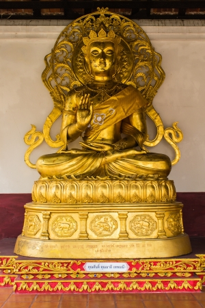 Buddha statue in wat Phra That Haripunchai photo