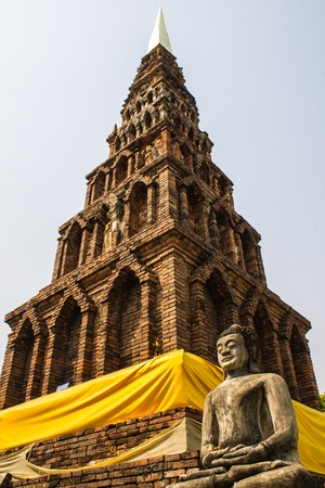 Buddha Statue , Old Chedi in Wat  Phra That Hariphunchai photo