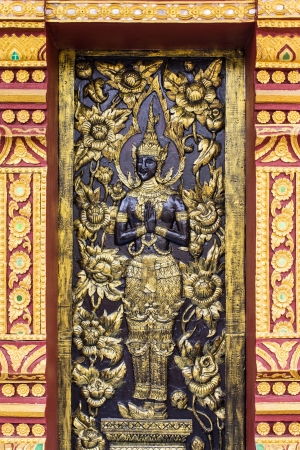 Ornament wooden door of Thai temple in Chiangmai, Thailand photo