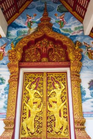 Ornament wooden door of Thai temple in Chiangmai, Thailand